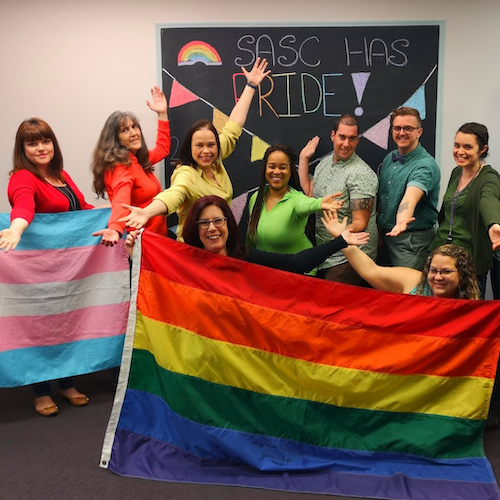 Sexual Assault Support Centre staff with the Pride flag.