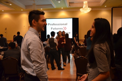 Two students converse at the Professional Futures conference.