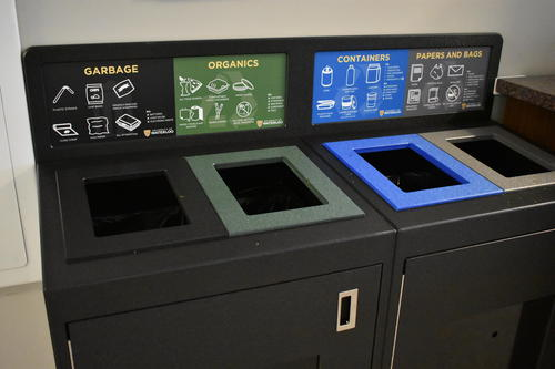 The colour-coded recycling and waste bins.