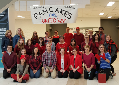 Members of Applied Health Sciences pose as a group at their annual United Way pancake breakfast.