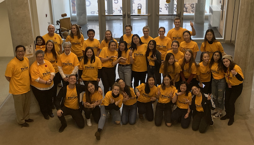 Members of the School of Optometry and Vision Science wear their Thrive Week t-shirts.