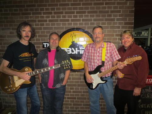Robyn Landers, Dave Tompkins, Dan Hergott, and Lawrence Folland are ready to rock at The Bombshelter.