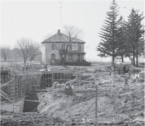 The Graduate House watches over the open construction site that would become the Douglas Wright Engineering building.