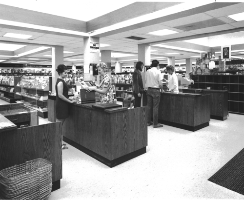 Bookstore staff assisting students with their purchases, circa 1972.