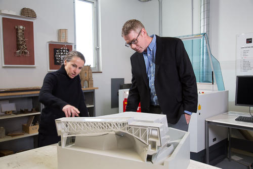 Anne Bordeleau, director of Waterloo's School of Architecture, and Scott Walbridge, director of Waterloo's architectural engineering program, look at the type of model that could be created by students in Engineering's newest program.