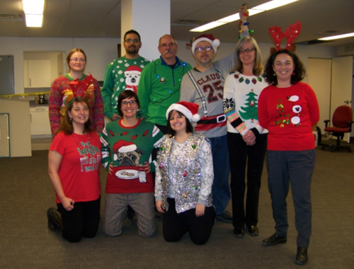 Members of Plant Operations show off their ugly Christmas sweaters.
