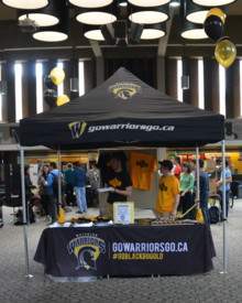 An Athletics booth set up in the Student Life Centre.