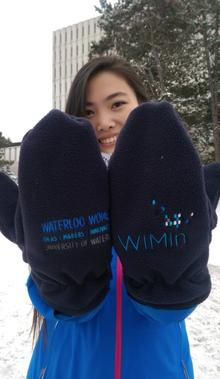 A woman shows off the Waterloo WIMIN mittens.