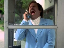 Ron Burgundy cries in a phonebooth.