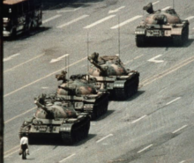 A lone man stands before a column of Communist tanks in this iconic image from 1989.