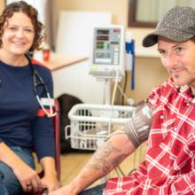 A man receives health care.
