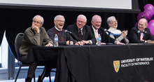Participants in a Mathematics 50th anniversary panel laugh together.