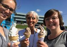 Waterloo employees with free ice cream and wide smiles.