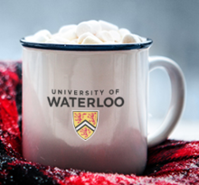 A University of Waterloo mug piled high with marshmallows.