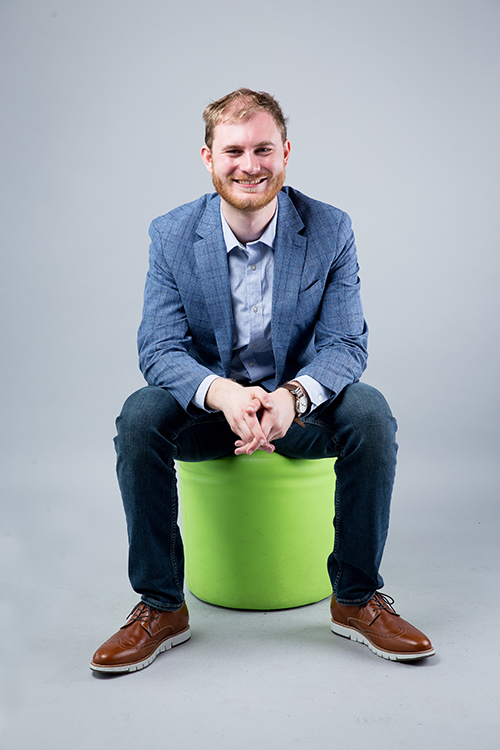 Max Niebergall sitting on a lime green box