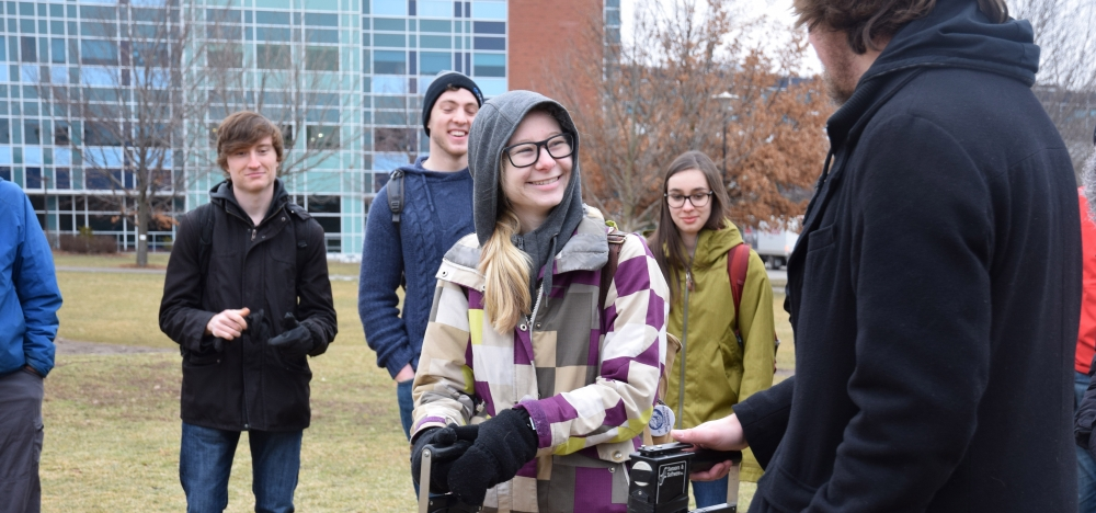 Sarah Griffith shown how to use ground penetrating radar by Dylan Klazinga.