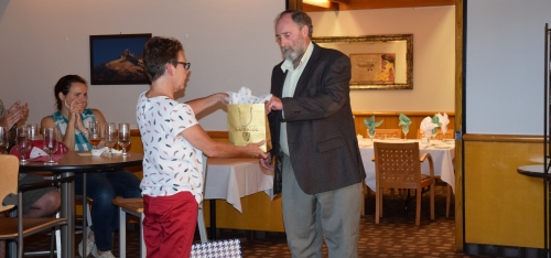 Bill Taylor receives a farewell gift from Lorraine Albrecht.
