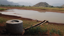 A rainwater harvesting system tank sluice in Tamil Nadu at low water levels.