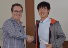 Norman Shieh receiving his KEGS scholarship from Vince Gerrie (left).