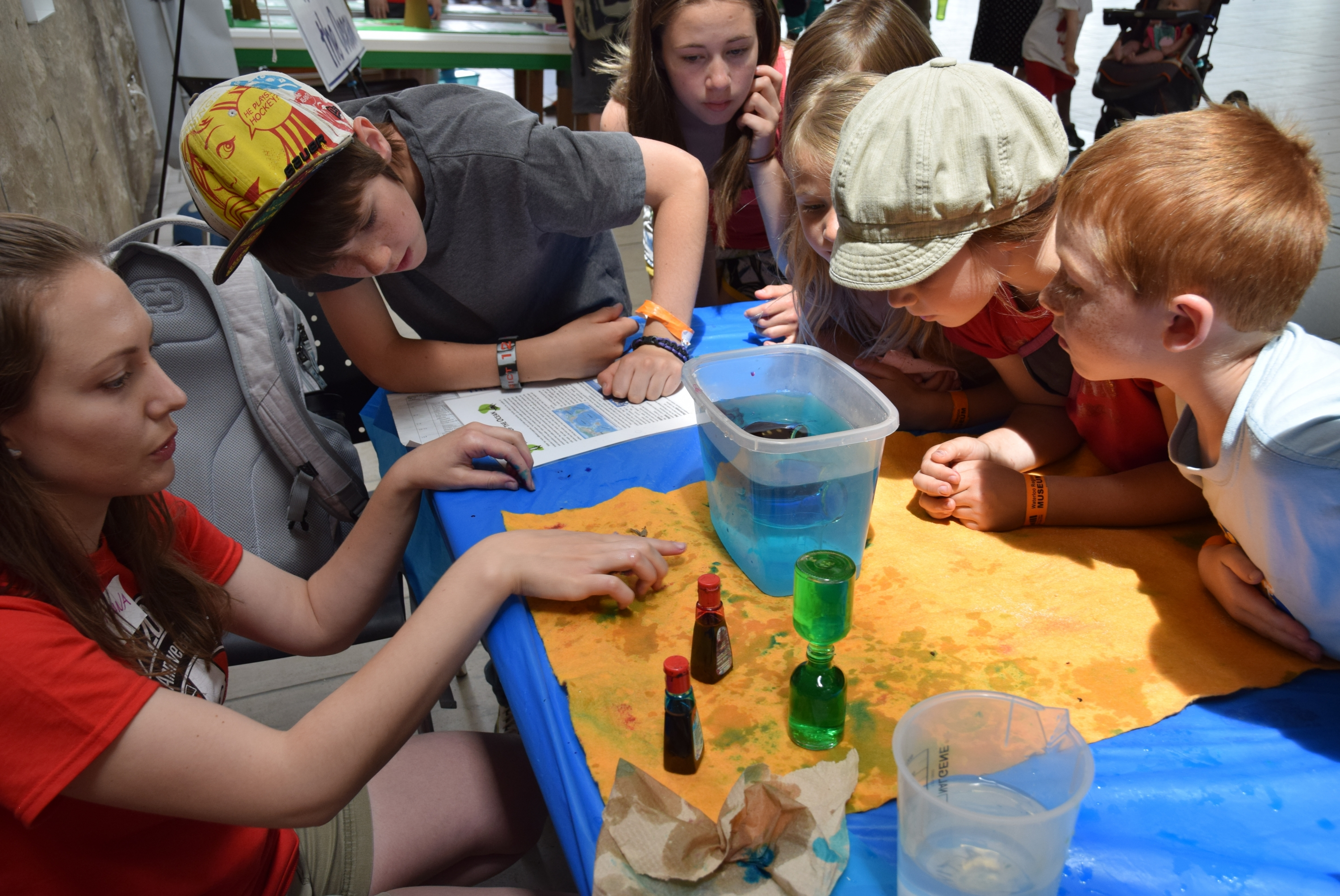 Volunteers doing an experiment with children at the Groundwater Festival.