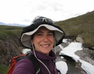 Tonya DelSontro selfie in front of a mountain stream