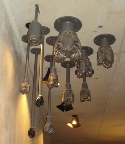 brown metal drill bits hanging from ceiling