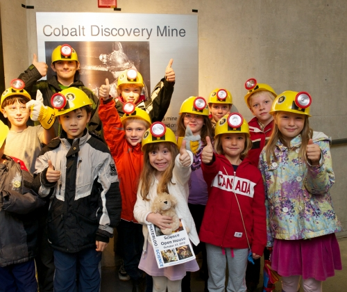 Children give a thumbs up in front of the newly unveiled mining exhibit