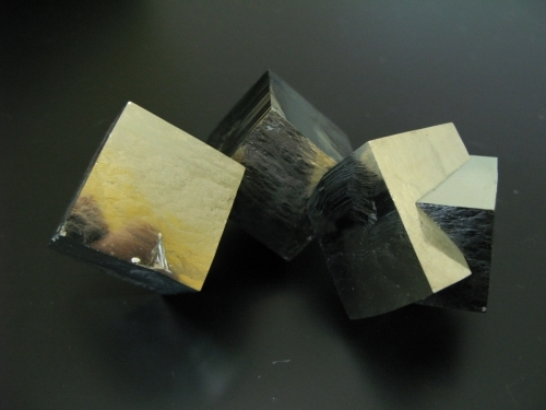 three cubes of gold-coloured pyrite