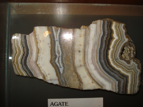 brown, white and grey banding in agate specimen