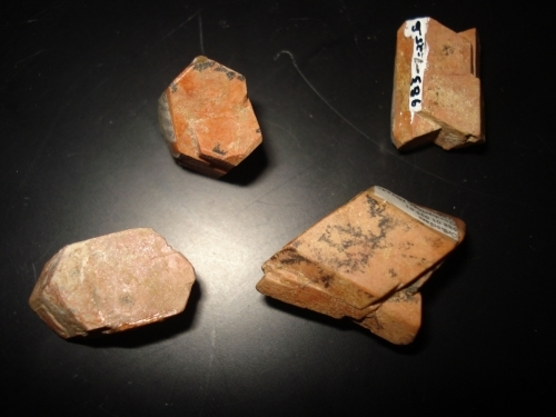 four small pink orthoclase feldspar crystals