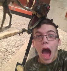 Jacob trembling beside the velociraptor