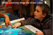 Child learning about Great Lakes