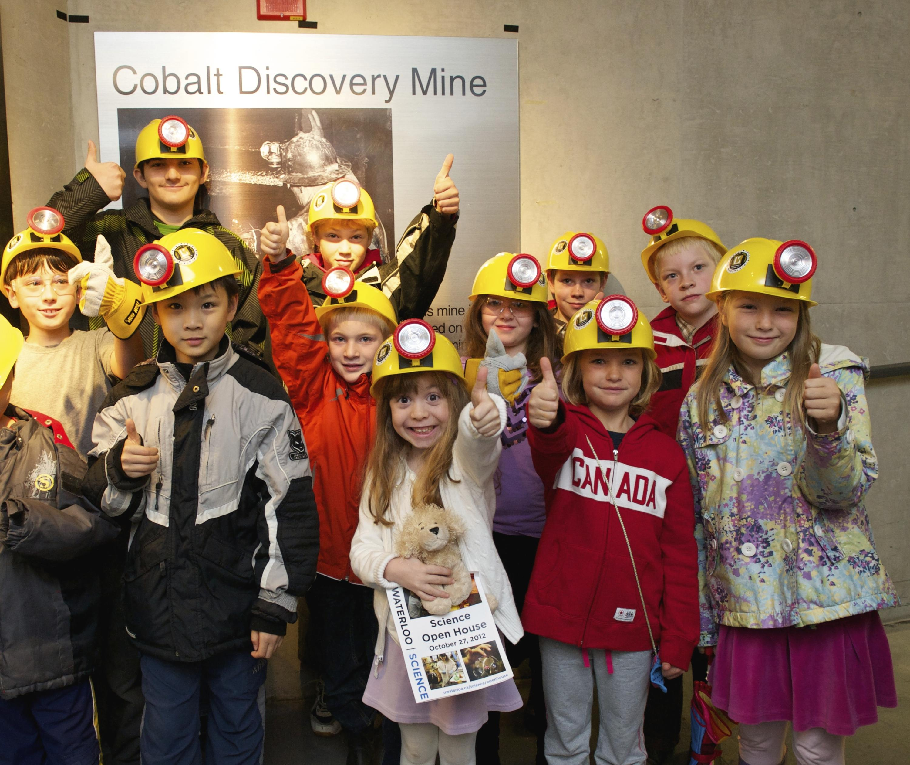 Class of children outside the mining tunnel