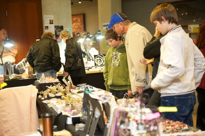 Visitors looking at gems and minerals at the Gem and Mineral Show