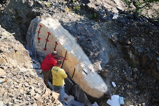 two men taking mould of real rock face