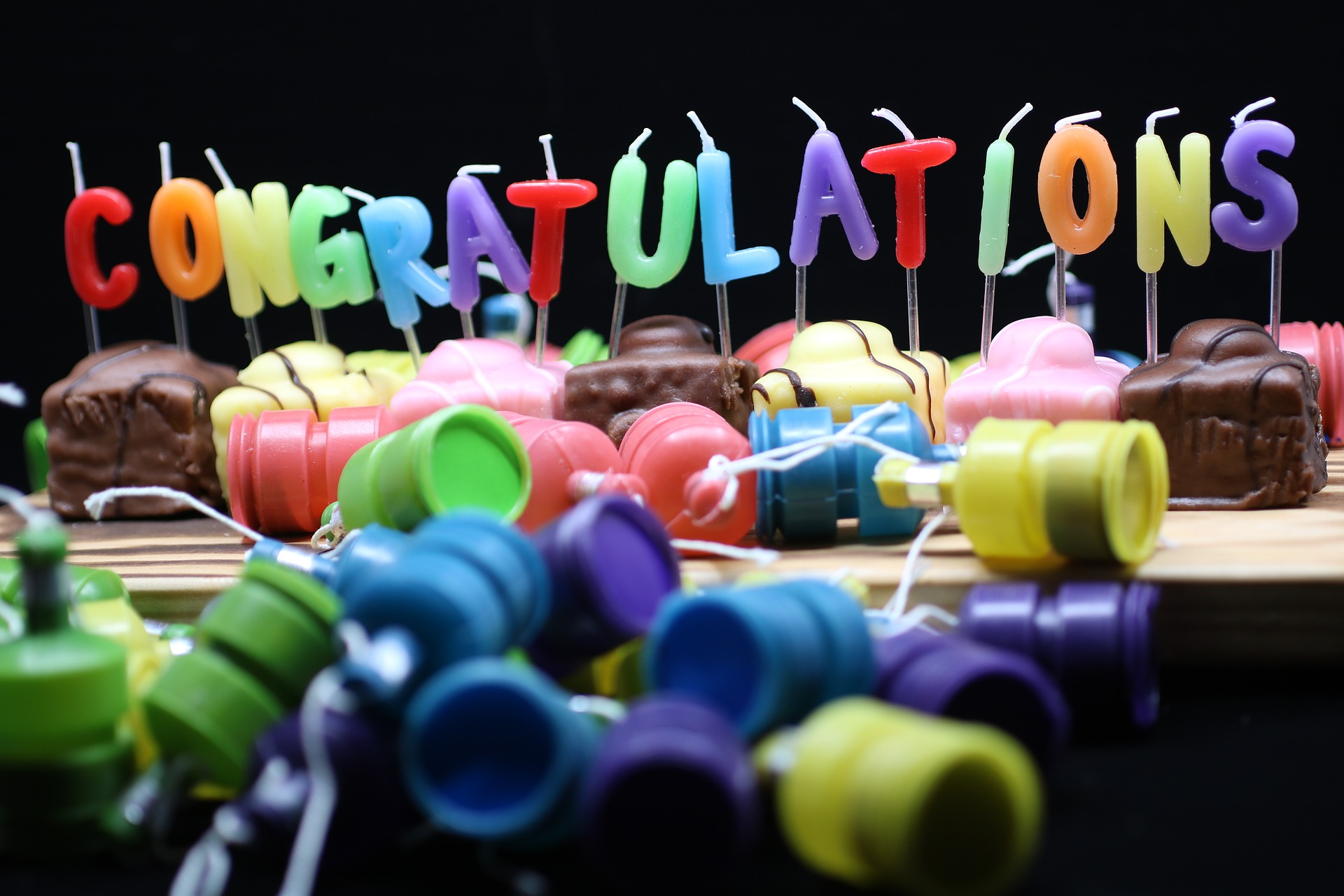 """Candles spelling out """"congratulations."""""""