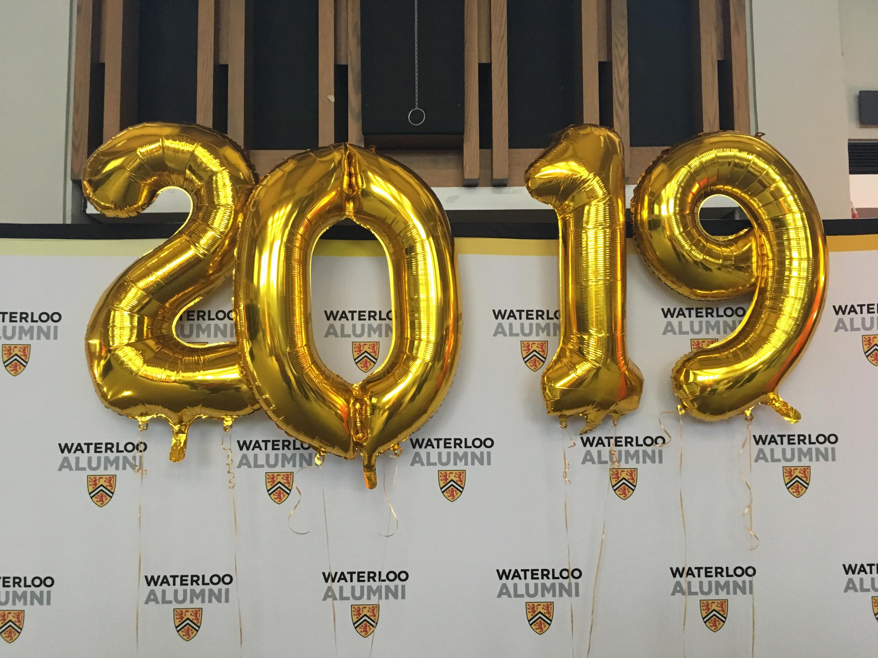 Four balloon numbers saying 2019