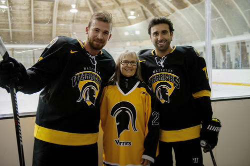 Mary Ann Vaughan and two hockey players