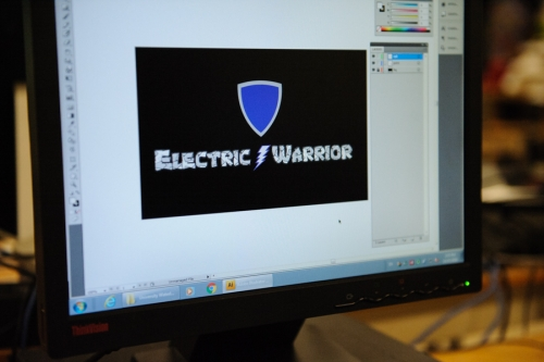 Electric Warrior logo on a computer screen