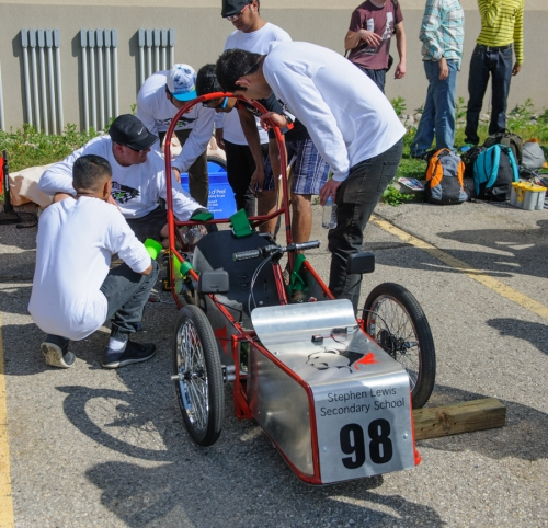 Stephen Lewis Secondary School working on their car