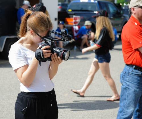 A student holds a camera