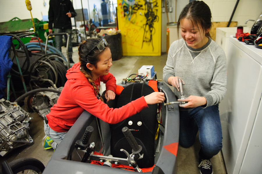 SJAM students Livia and Helen fit the rollbar to car 703