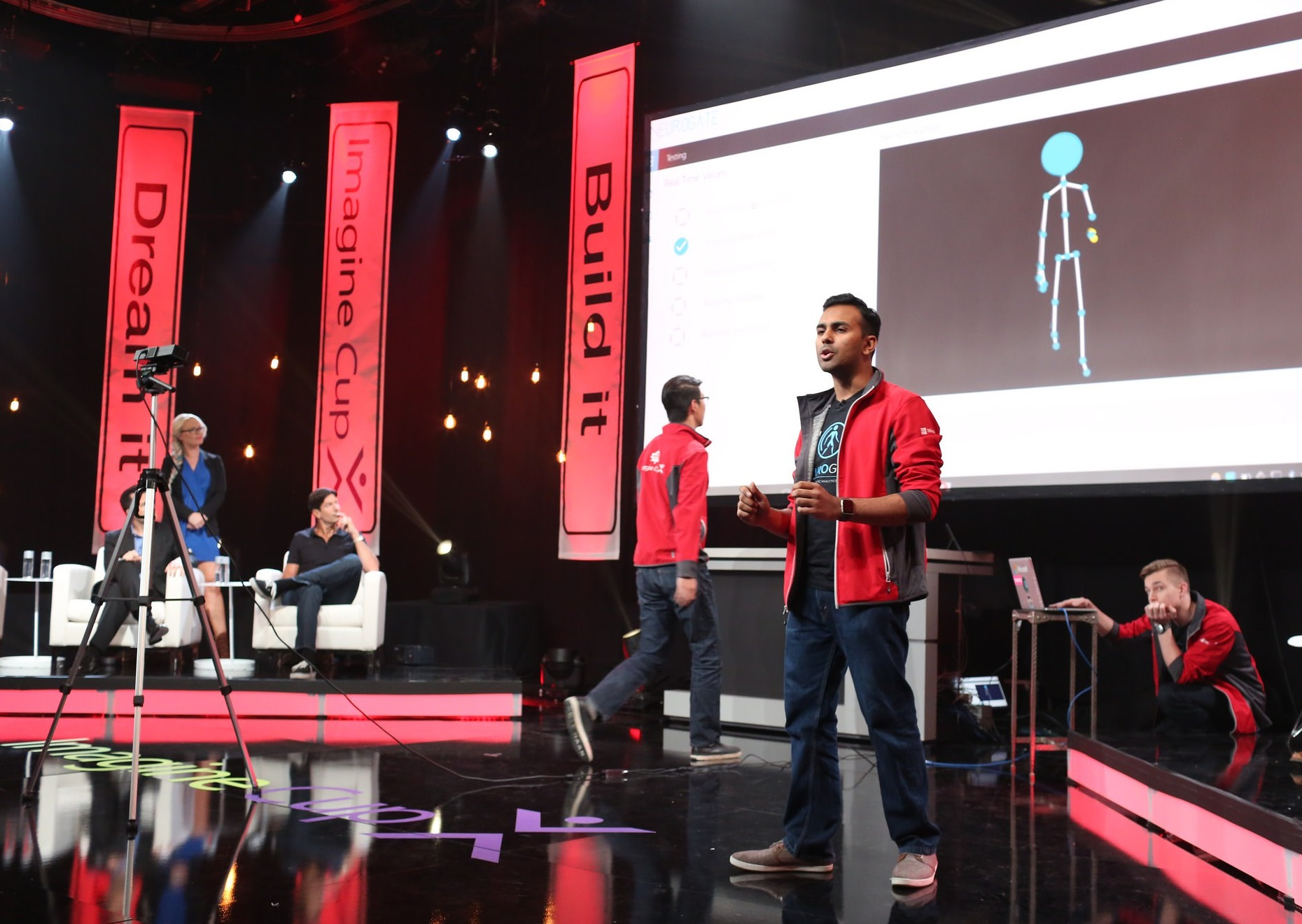 NeuroGate members Zeqi Cui, left, Hrishikesh Suresh, centre, and Declan Goncalves, right, make their pitch and give a demonstration at the Imagine Cup international finals in Redmond, Washington.