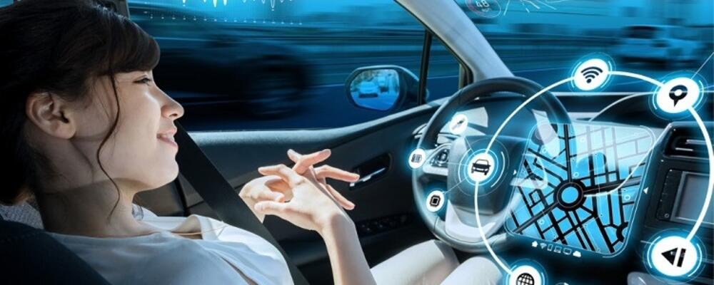Girl relaxing in a moving autonomous vehicle