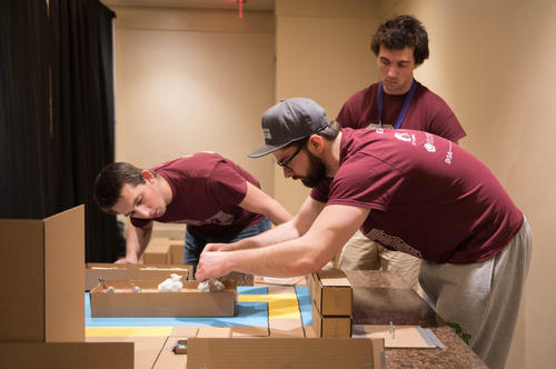 students building in competition