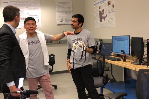 Ning explaining EEG to the reporter