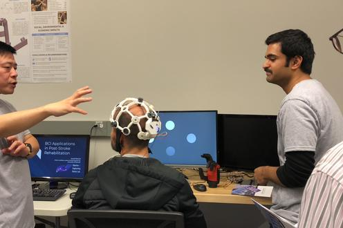 Ning explaining how EEG cap works