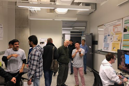 People visiting eBionics lab at Engineering 7 open-house demo