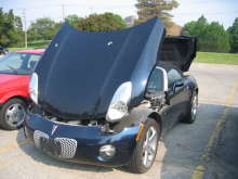 Pontiac Solstice with front and rear deck lids open