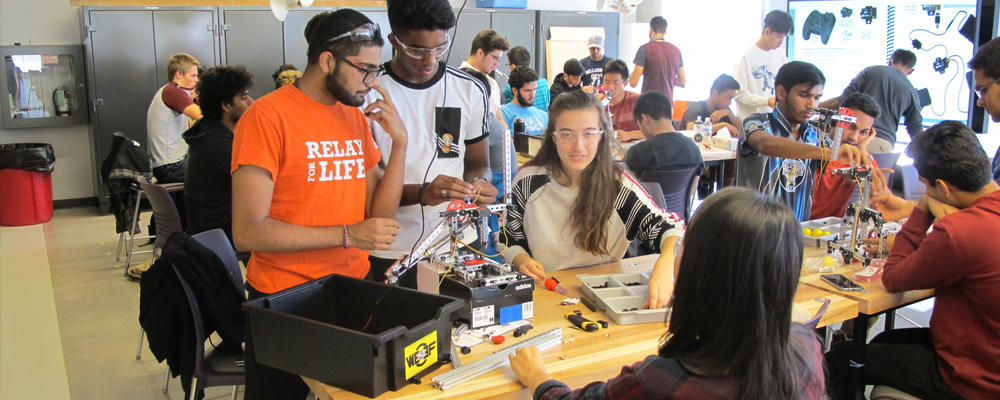 Mechatronics students working on their design day project